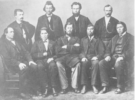 """The """"Western Chiefs Delegation"""" photo from left to right standing: Charles Schooler Beeson (clerk at the agency), Thomas F. Richardville, G. Adolphus Colton (Indian Agent), and Captain Sims* (local U.S. Army officer).  Sitting from left to right: David Geboe, Peter Lafalia, John B. Roubideaux, Thomas Miller, and Louis Lafontaine*.  Those names marked with * still need additional confirmation before we can say with 100% certainty that the identification is correct."""