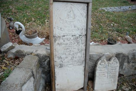 Headstones from the Miamitown cemetery.  On the left is the stone for Mary A. Geboe (the wife of Eli Geboe) and her son Brutus.  The stone on the right is believed to be from one of the early non-Myaamia settler families, but as of publication this has not been confirmed.