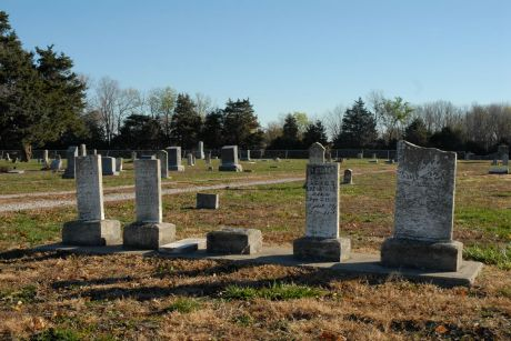 Headstones of Lafontaine family members in the Fontana Cemetery.  From left to right: James O. Lafontaine, Lewis J. Lafontaine, Agnes F. Lafontaine (her stone is lying flat in the center), Louisa Lafontaine, and Unknown (possibly a child who died shortly after birth).  All five died young and were the children of Louis Lafontaine and Mary Magdalene Lafontaine (Bourdon).