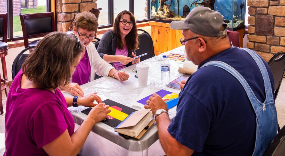 Participants of the 2019 Adult Experience painting Myaamia designs