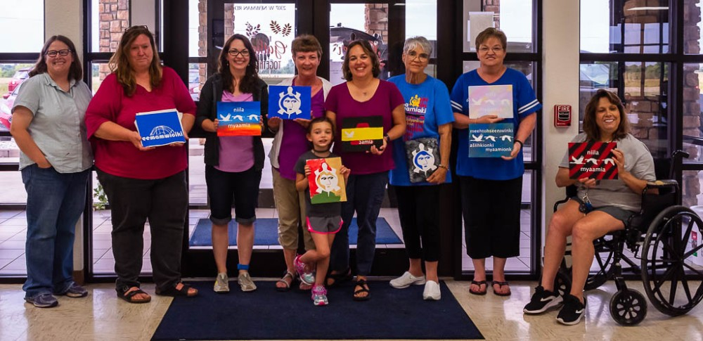 2019 Adult Summer Experience participants displaying their completed paintings