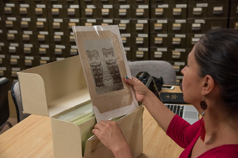 A Haida Language participant viewing an archived photo during National Breath of Life Archival Institute at National Anthropological Archives, Suitland, MA. 2017.